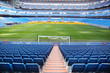 Empty football stadium with blue seats, rolled gates - 51435712