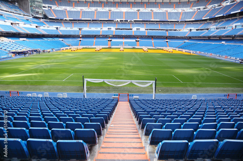 Foto op Aluminium Stadion Empty football stadium with blue seats, rolled gates