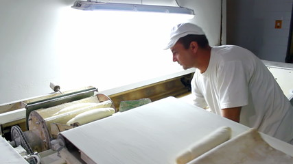 Worker in the production of bread