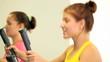 Group of slim women exercising on cardio machines