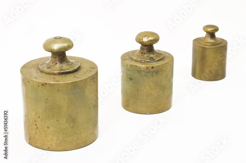 Three antique weights isolated on white