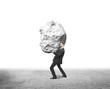 businessman holding rock