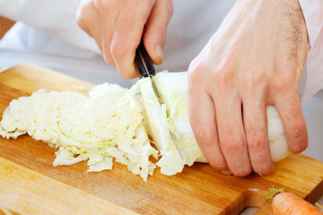 Close up of chef cooking lettuce