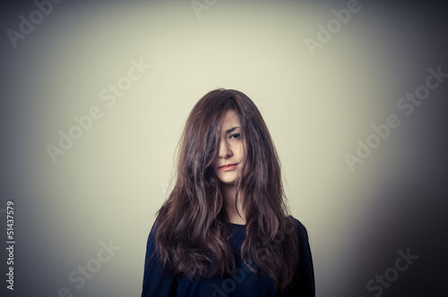 serious woman with long hair