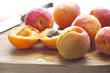 apricots on wooden cutting board