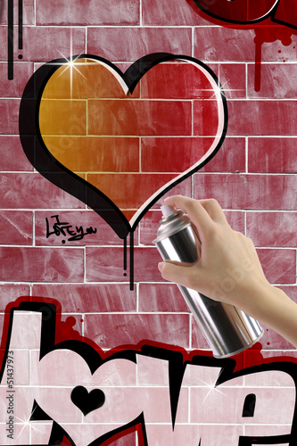 Heart graffiti on red brick wall