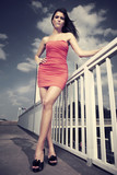 Fashion beauty posing on bridge