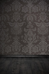 vintage room with floral wallpaper and wooden floor