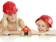 Two girls with helmet want to build a house