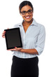 Sales representative displaying tablet pc for sale