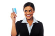 Woman displaying her credit card