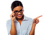 Woman adjusting her spectacles and pointing away