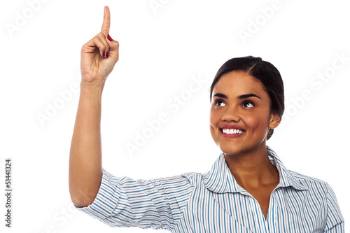 Corporate woman pointing upwards