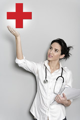 female doctor holding a red cross