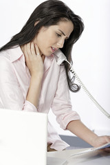 Woman with neck pain at desk