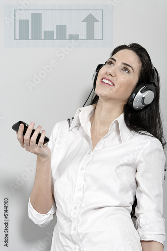 Woman holing out phone displaying volume
