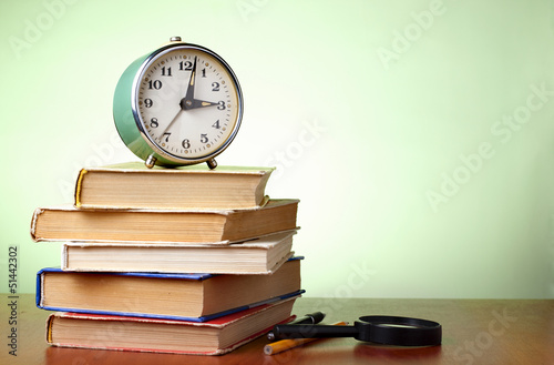 books and an alarm clock