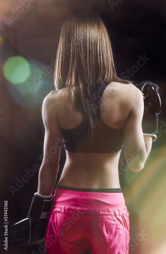 back muscled young female boxer, fitness