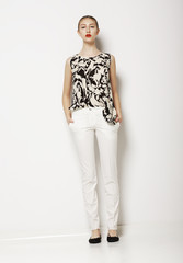 Stylish Woman in Light Clothes over White Background. Fashion