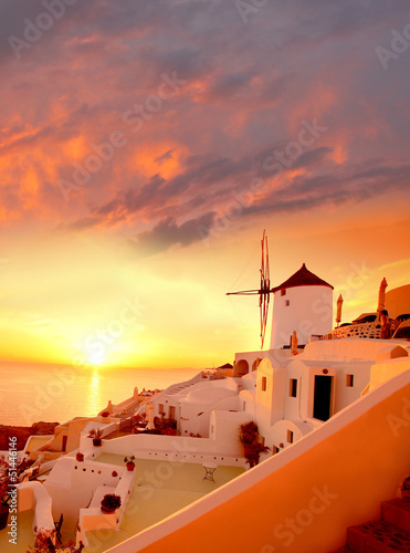 Naklejka Windmill in Santorini against sunset, Greece