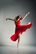 Ballet dancer wearing red dress over grey