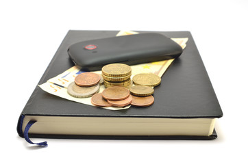 notebook, mobile phone, coins and banknotes