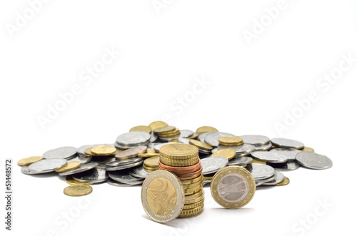 stack of coins near a heap of coins