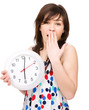 Young woman is holding big clock
