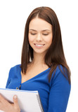 smiling young businesswoman with notebook