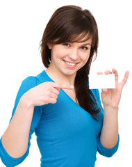 Young woman is holding visit card