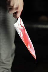 Man holding bloody knife