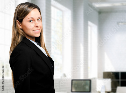 Beautiful businesswoman in her office