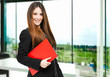 Young businesswoman holding documents