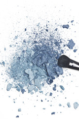 Crushed blue eyeshadow with makeup brush