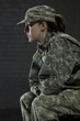 Young army woman dealing with Post Traumatic Stress Disorder