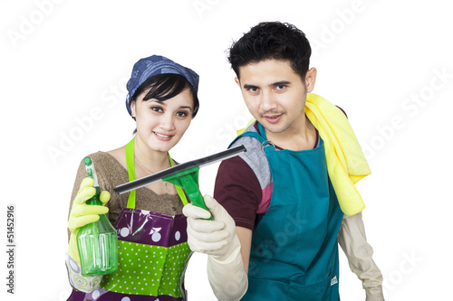 Young couple cleaning copyspace - isolated