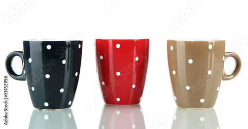 Three cups of polka dot isolated on white