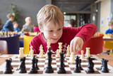 Young chess player at a tournament