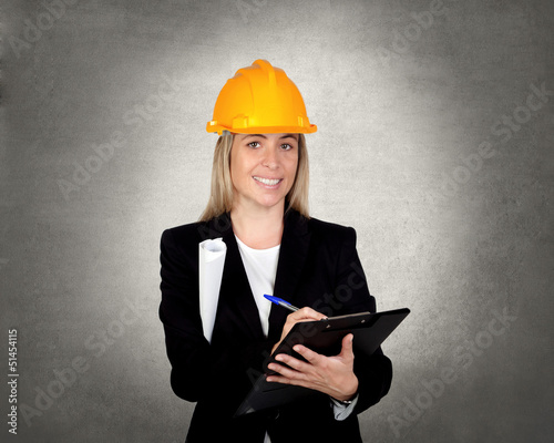 Attractive engineer with clipboard