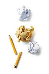 Broken pencil and crumpled paper