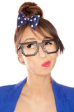 Nerdy thoughtful young brunette woman wearing 8 bit glasses