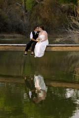 Kissing Female Couple at Lake