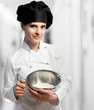female chef holding stainless bowl with flour