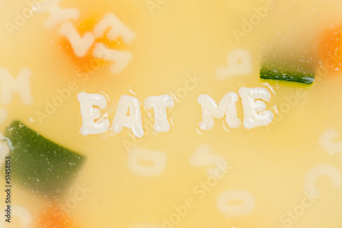 Alphabet soup drawing the words Eat Me