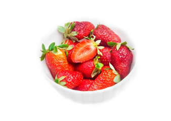 Bowl of strawberries over white