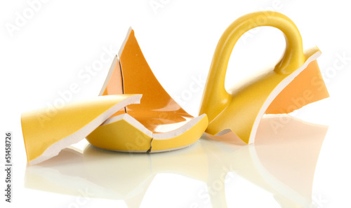 Yellow broken cup isolated on white