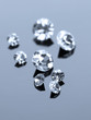 Beautiful shining crystals (diamonds), on grey background
