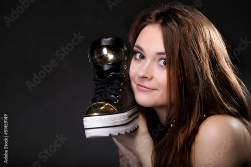 Girl with casual shoe. Women loves shoes concept.