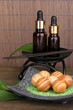 aromatherapy setting on brown bamboo background .
