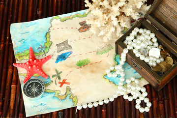 map of treasures on dark wooden background